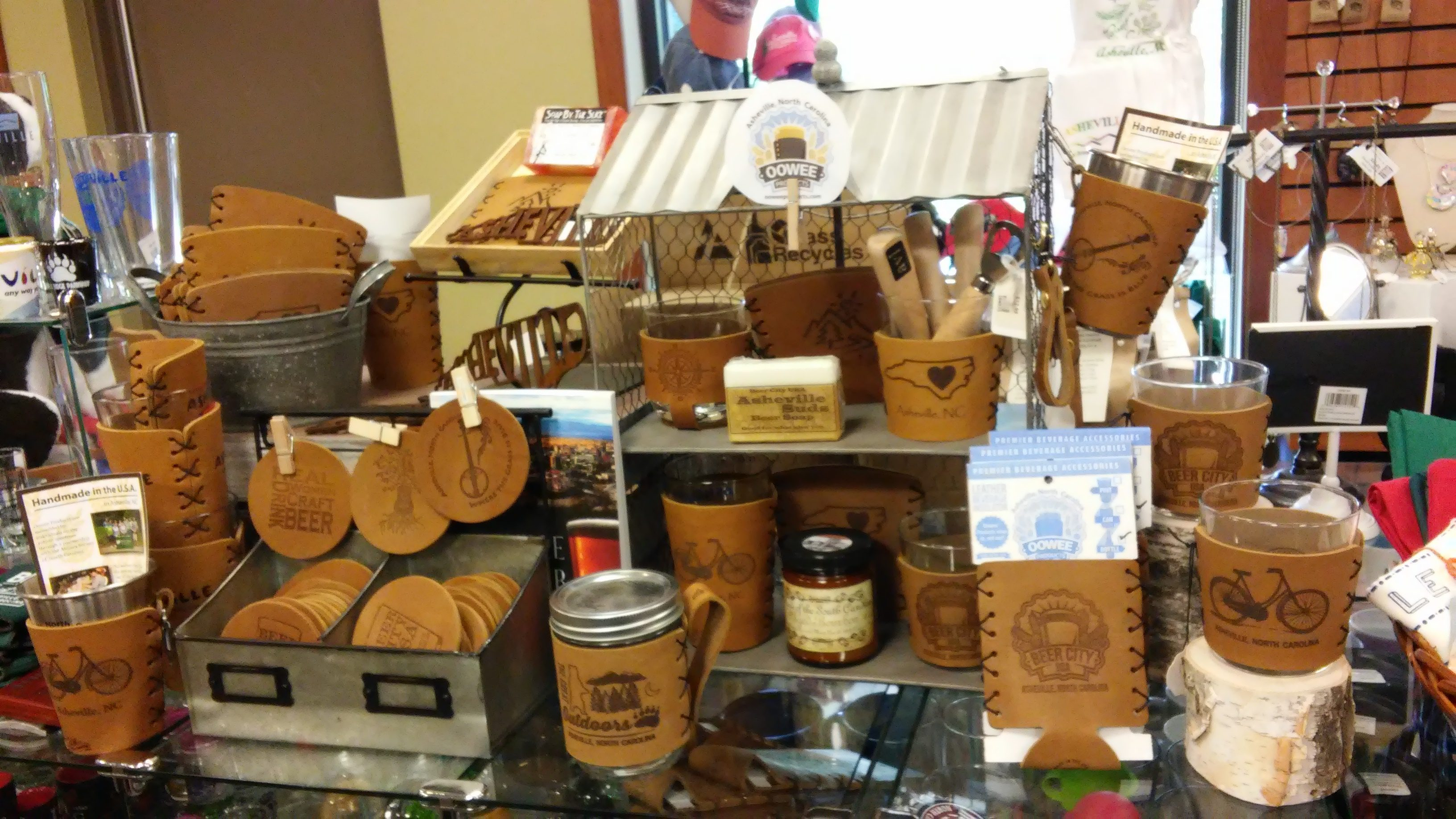 Oowee leather sleeve display at the Asheville chamber of commerce.